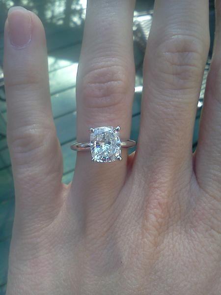 Cushion cut solitaire with slightly elongated look and thin band. Reminds me of my Peridot ring. :)