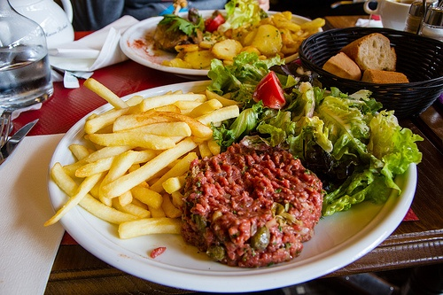 Beef Tartar in Paris. This dish was everywhere there. Tasty but you do wonder if it's 1) Horse and 2) Will you get sick.    In general food at cafes in Paris was pretty repetitive. So if you want something nice you might have to research ahead of time or pay more for a nicer sitting