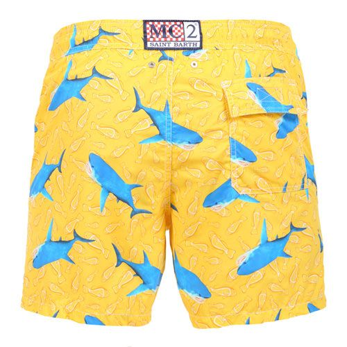 GUSTAVIA SWIM SHORTS WITH SHARK PRINTYellow GUSTAVIA long Swim Shorts, with tone on tone fish print and contrast all-over shark print. Two side pockets. Back Velcro flap pocket. MC2 label on waist to the reverse. Elastic waistband with adjustable drawstring. Internal net. COMPOSITION: 100% NYLON. Model wears size M, he is 189 cm tall and weighs 86 Kg.