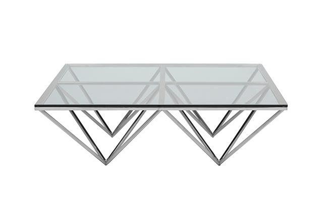 This coffee table offers a stylish geometric display, with it's clear glass top and choice of brass or stainless steel frame creating a unique point of difference to any living room. Featured on Real Living