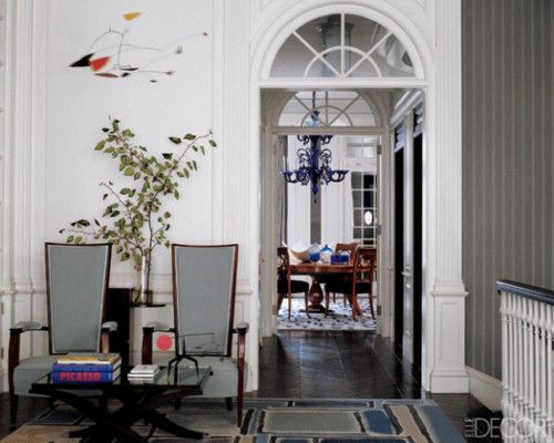 Captivating A 1952 Mobile By Alexander Calder Is Suspended Over A Pair Of Upholstered  French Armchairs In The Living Room