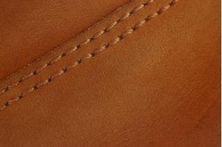 The trick to sewing leather with a standard sewing machine is having the right accessories, and garment- or accessory-weight leather. If the leather is thicker than that, you'll need a heavy duty or industrial sewing machine. You also need a brand new sharp leather needle fitted with an arrowhead-type cutting point; heavyweight thread; and an...