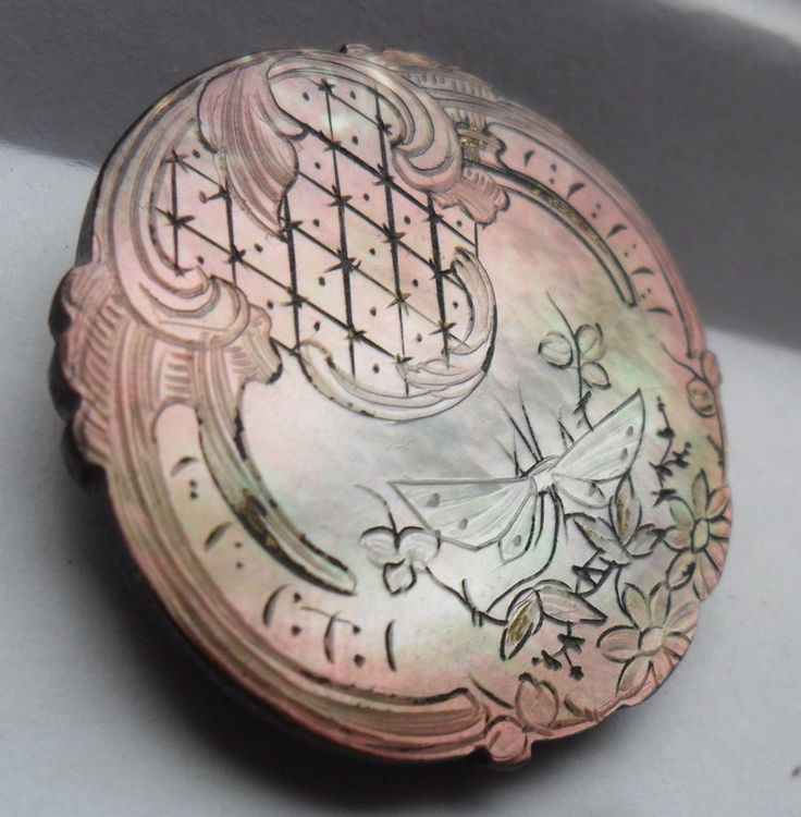 Carved Mother-of-Pearl with butterfly.