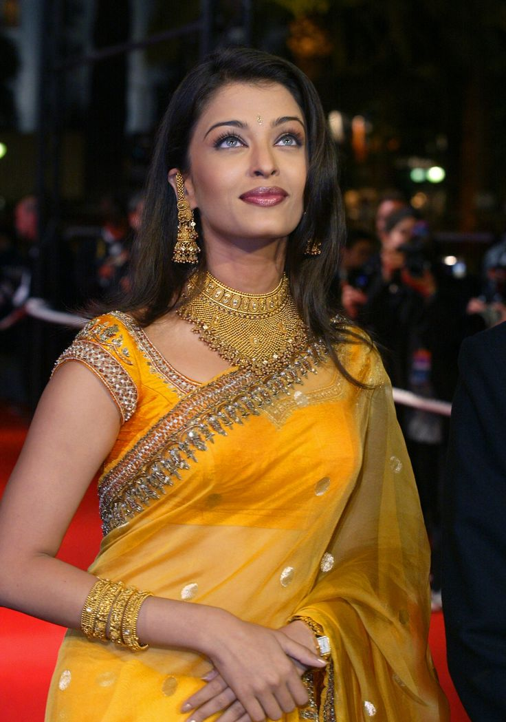 """Attending the premiere of her film """"Devdas"""" at the 2002 Cannes Film Festival wearing a beautiful yellow-orange embroidered sari"""