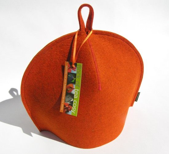 Modern tableware: This is the flock's classic, modern, curved profile with its centre dart done with zig-zag 'baseball' stitching.   It is made from thick (3mm), 100% top-quality wool felt from Europe in the very popular Burnt Orange colour — which goes with everything.  SIZE: STANDARD   25″ circumference and 9″ height fits most average-size (32oz or 4 cup) tea pots.  Dubbed 'the baseball' for its round profile and zig-zag stitching.
