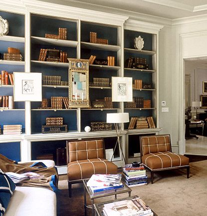brown books, navy accent and artwork :: Suzanne Kasler