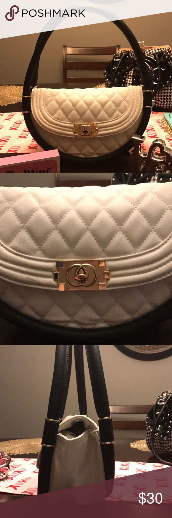 Black & White Circular Chanel Copied Purse B & W purse replica to Chanel. Front open w/ plate & knob to secure it. W fabric is sturdy & quilted pattern front to back. Bottom fabric is plain. Black oval handles go all around, there's 2 of them & they separate so it's secure if u fill it more.  Inside there's one pocket that has a zipper. Pics showing different measurements of several angles. It's a shoulder strap from your shoulder down to above your hip. Gold accents on clasp & center of…