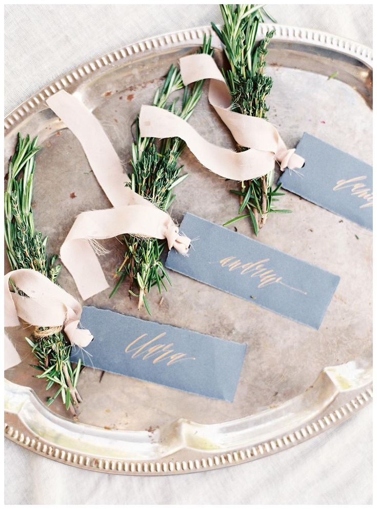 Place cards with rose gold calligraphy, blush pink ribbon and rosemary detail. Calligraphy by Olde York Station. Image by Allison Kuhn Photography.