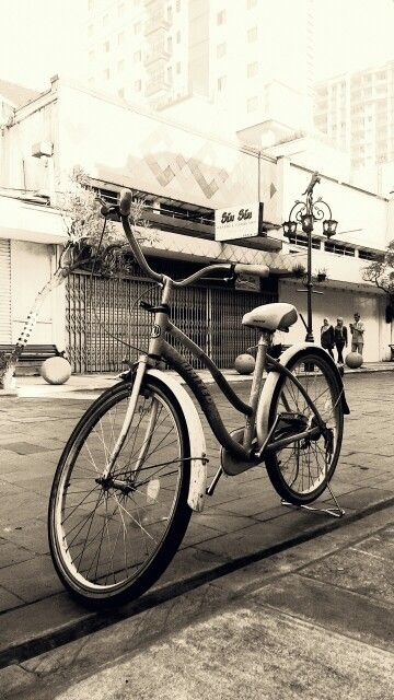 old bicyle in Braga Street, Bandung City, West Java, Indonesia edited by pixlr app