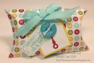 "Bouncing Baby pillow box ~ Paper:  ""Bandstand"" (from a Simply Scrappin' Kit) #126928  Stamps:  ""Button Buddies"" Wood Mount #122735    Clear Mount #122737  ""That's the Ticket""  Wood Mount #128072    Clear Mount #128075   Ink:   Cherry Cobbler #126966  Pool Party #126982  Accessories:  ""Brights"" Buttons #119747  Pool Party Ruffled Ribbon #122975"