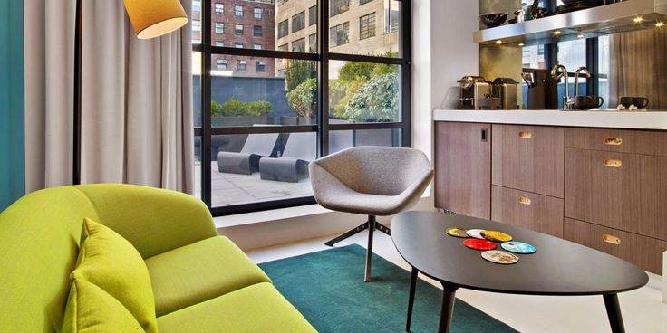 A Hidden NYC Mystery Hotel: Many rooms have seating areas and all have fully stocked kitchenettes.