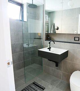 Recessed shower & ledge under shaving cabinet