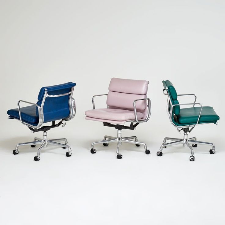 CHARLES AND RAY EAMES; HERMAN MILLER Eames Soft Pad Chairs in three different colors of leather