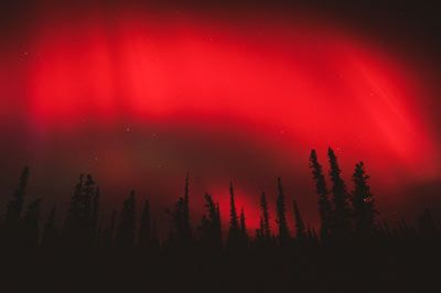 How does the aurora borealis (the Northern Lights) work? - HowStuffWorks  - The Carrington Event witnessed by Marty and Kezia in the novel AURORA REDRESS by Zina Abbott was characterized by a red aurora.