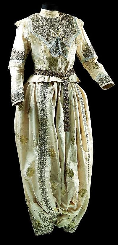 Traditional bridal (& festive) costume. Style: 1925-1950; an example of the 'Bahriye' (Marine) style, which was popular in western Anatolia in the 1920s-1930s.  Adorned with metal thread embroidery (in 'tuturma' technique) on dark green velvet.  Such costumes are still (hand-)made and used/sold/rented for marriages in Eskişehir (central district and Seyitgazi).