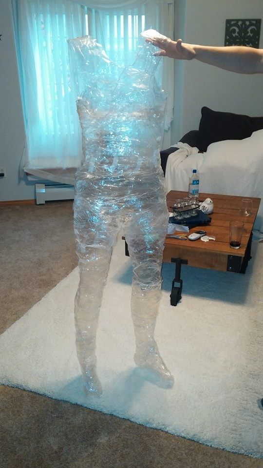 Halloween tape ghost. Wrap a person in sections in packing tape. Sticky side out first then sticky side on top. Then cut down the side and tape together at the end. Fun if you spray glow in the dark paint on it and hang it from a tree or hide it in your house!!