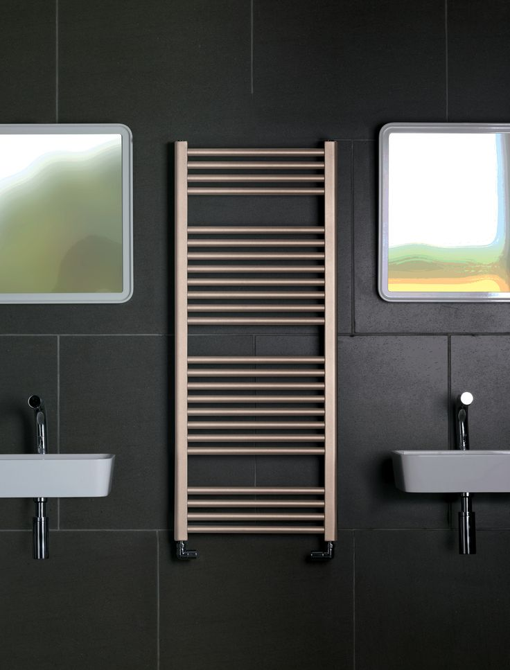 The Bisque Deline radiator in Beige Quartz contrast perfectly with this  black bathroom design.