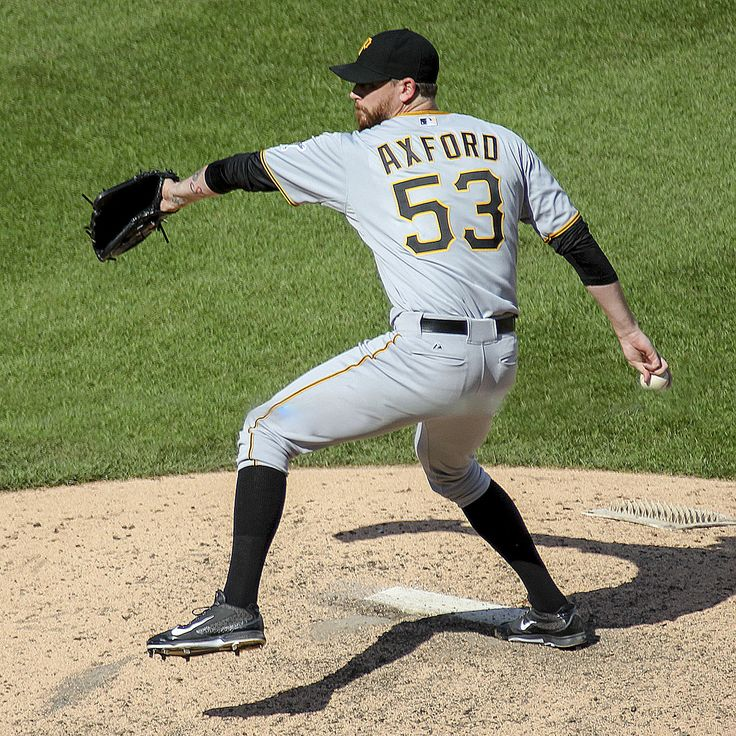 John Axford from Port Dover, Ontario, is currently a free agent pitcher, shown here with the Pirates.  In 2011 when a member of the Milwaukee Brewers, Axford led the National League in saves and appeared in 6 postseason games, winning three of them.  His handlebar mustache and pitching style remind fans of Hall of Famer Rollie Fingers.