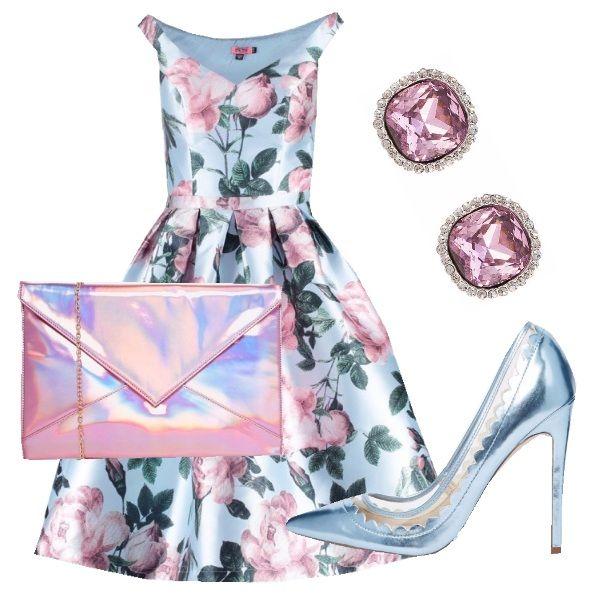 Outfit adatto ad una cerimonia o ad una serata elegante composto da abito con gonna a ruota che esalta il punto vita. La scelta degli accessori in colori metallici e che richiamano i toni dell'abito conferiscono luce e preziosità all'outfit.
