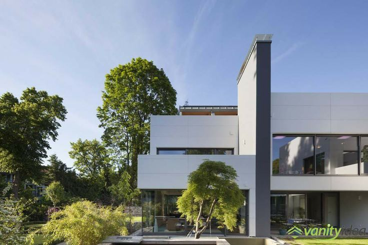 he residence's exterior is HI-MACS® cladding and symmetrically arranged panels, white and grey facades along with a modern design