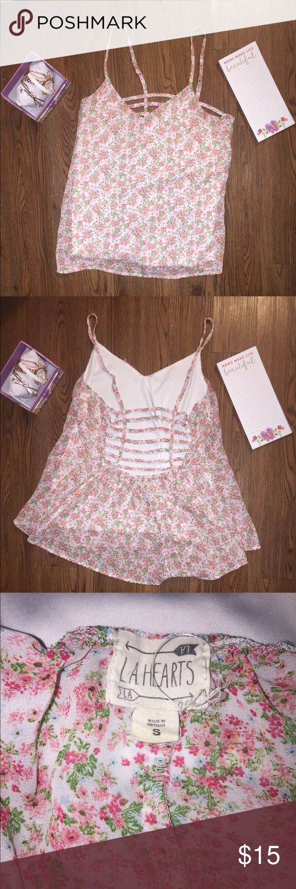 Pink Floral Flowy Ladder Back Tank LA Hearts pink floral and flowy ladder back tank. Adjustable straps, 100% Polyester. Size Small. Small tear on the left upper chest area. La Hearts Tops Tank Tops