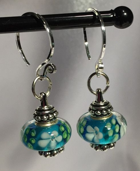 sweet blue murano lampwork beads used on a beadholding fixture the lampwork beads