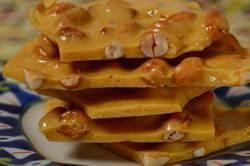 Peanut Brittle has a delicious sweet buttery flavor and hard and crunchy texture that seems to literally melt in your mouth. From Joyofbaking.com With Demo Video