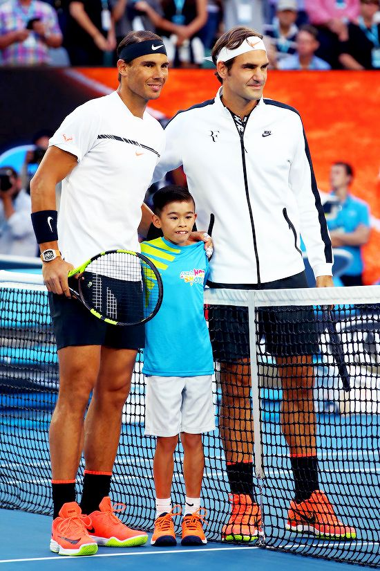 """Rafael Nadal and Roger Federer pose for a photo at the net ahead of their Men's Final match on day 14 of the 2017 Australian Open at Melbourne Park on January 29, 2017 in Melbourne, Australia """
