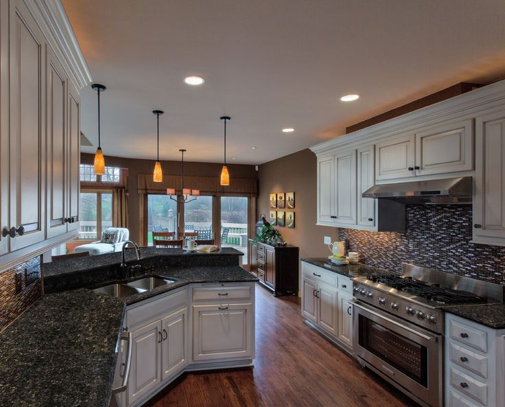Blue Pearl Granite Countertops Bring Luxury and Beauty to Your Kitchen: Top Knobs With Mosaic Tile Backsplash Also Blue Pearl Granite Countertops And Pendant Lighting With Hardwood Floors Plus Sideboard And Interior Paint