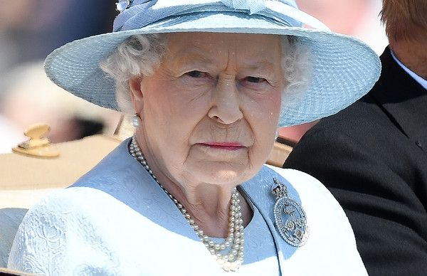 Britain's Queen Elizabeth II travels in a horse-drawn carriage past Buckingham Palace on her way to Horse Guards Parade for the Queen's Birthday Parade, 'Trooping the Colour', in London on June 17, 2017. More than 600 guardsmen and cavalry make up the parade, a celebration of the Sovereign's official birthday, although the Queen's actual birthday is on 21 April. / AFP PHOTO / Chris J Ratcliffe