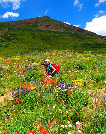 Hiking from Aspen to Crested Butte in July yields AMAZING vistas of colorful wildflowers.