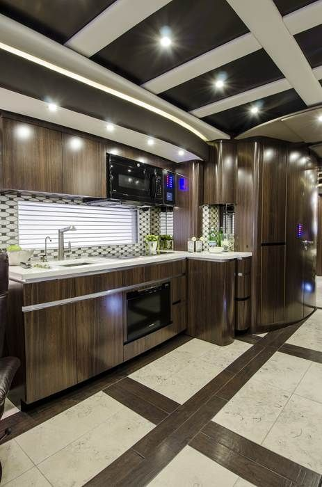 Photos: The world of million-dollar motorhomes Traditional house amenities and luxuries -- stacked washer and dryer, convection oven,SubZero refrigerator, garbage disposal, four-burner premium induction cooktop -- are all found in this coach.