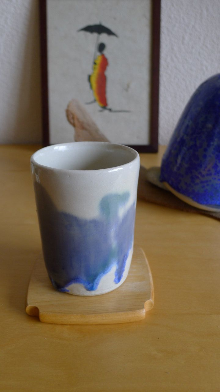 Handmade ceramic cup. Glossy white with abstract paintings from crystal glaze by OrientalSpectrum on Etsy