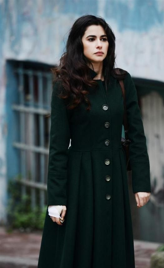 Green coat Nesrin Cavadzade