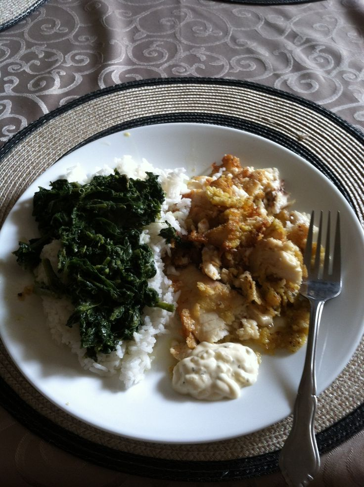 Tortilla chip encrusted tilapia and spinach over rice. Experimental recipe