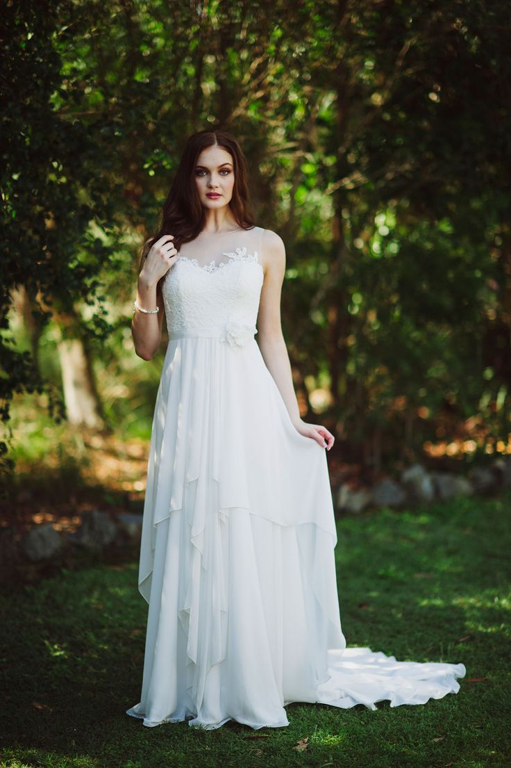 Fleur features a moden illusion neckline and back with a dreamy, floaty skirt.