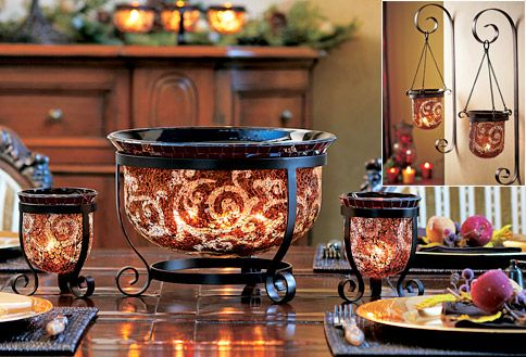 Amaretto Swirl by Partylite  Each piece is finished with a layer of crushed artisan glass, a mosaic rim and aged brown metal accents.  My all time favorite PartyLite collection!