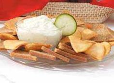 Benedictine Spread -- Cucumber spread. Low-fat ingredients can lower the calories and fat. According to the website, 2 tablespoons (calculated without pita bread and snack rye) equals 66 calories, 6 g fat, 18 mg chol, 96 mg sodium, 1 g carbs, trace fiber, 1 g pro.