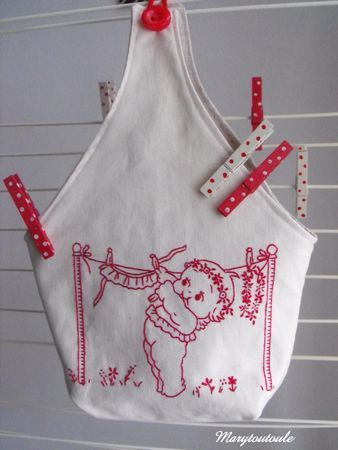 Oh my.... clothespin bag. red thread - forget the traditional embroidery name....