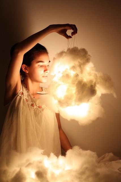 Heaven - Cloud lights.   First, you need some cotton batting, a paper lantern, and three flameless candles. Pull at the cotton batting until it looks fluffy, light, and cloud-like. Then, hot glue it to the outside of the paper lantern in various places. Make sure its fluffed to your liking, then light the lights and stick them inside.