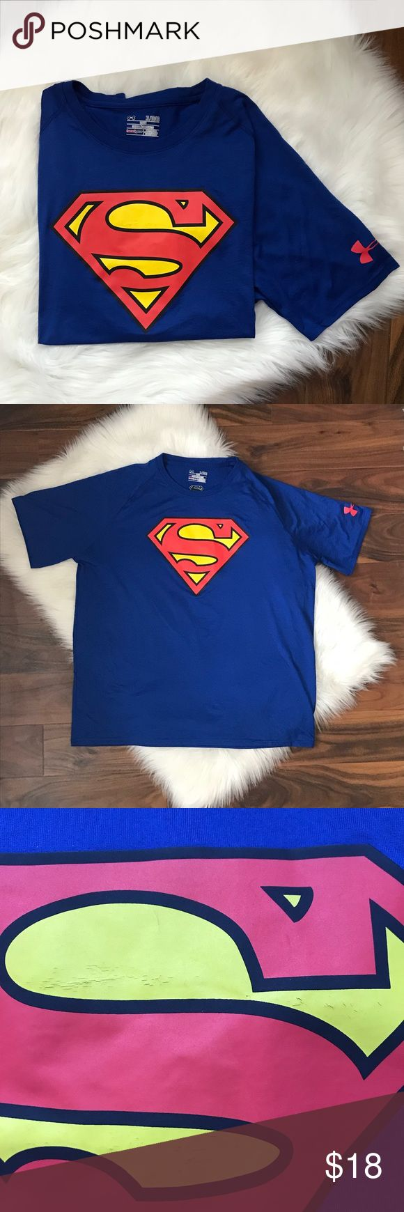UA Superman workout t shirt Under Armour Superman workout short sleeve t shirt. Slight cracking on Superman symbol as shown in photos. Men's SZ extra large loose fit. Under Armour Shirts Tees - Short Sleeve
