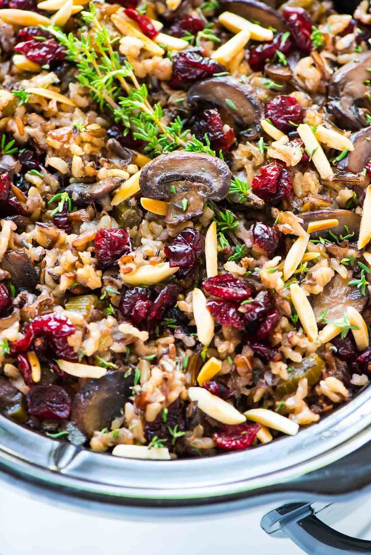 Crock Pot Stuffing with Wild Rice, Cranberries, and Almonds. The BEST gluten free stuffing recipe. The slow cooker does the work. Easy and everyone loves it! Perfect make ahead side for Thanksgiving. {vegan, dairy free} Recipe at wellplated.com   @wellplated