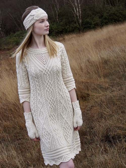 Beautiful Aran dress with scallop lace stitches, also featuring lace stitching on the neck line of the garment with an A line feature coming out from the waist.  Lovely vintage dress look. PLEASE NOTE: * This garment has regular length sleeves and not 3/4 length sleeves as shown in picture.
