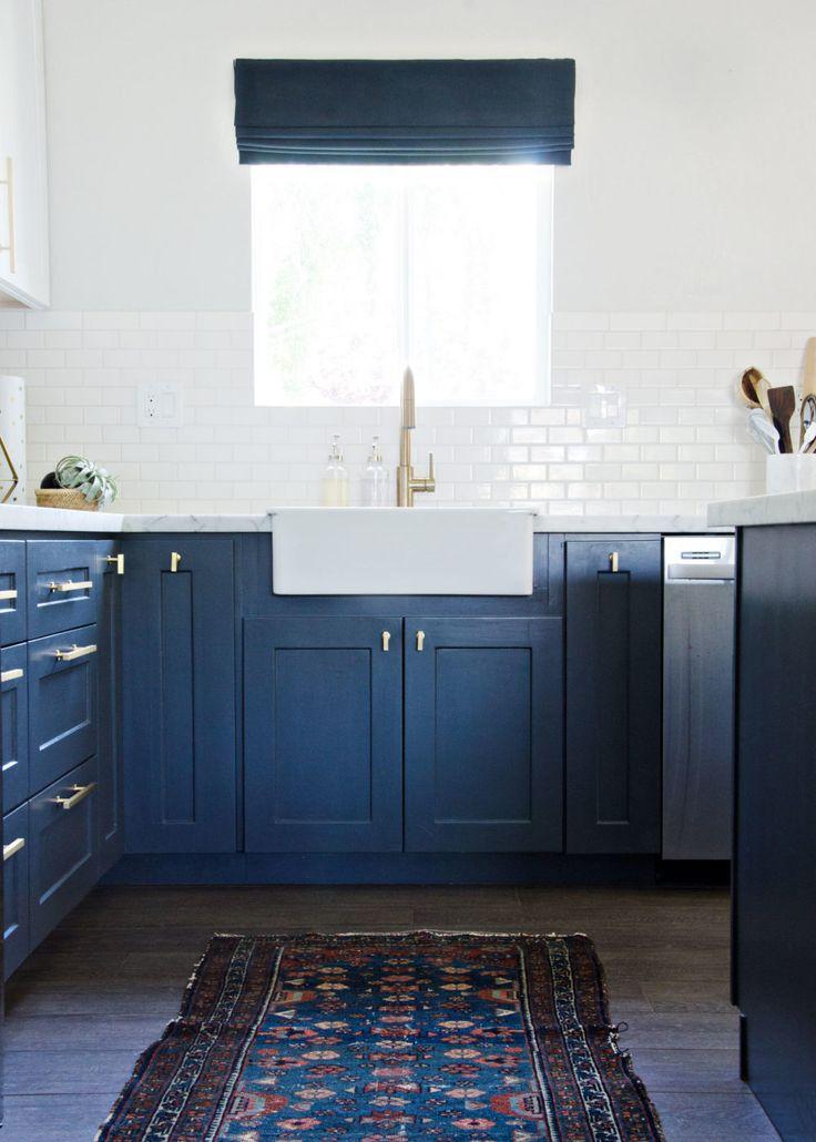 White and navy kitchen design with glossy white tiled backsplash | The Vintage Rug Shop