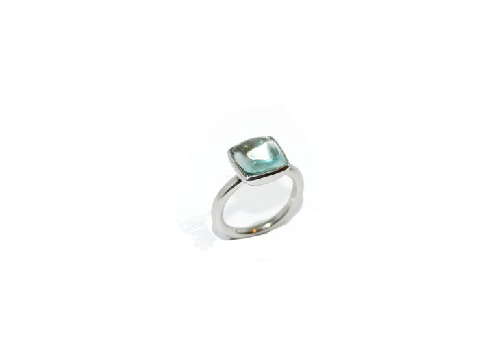 A 9ct white gold ring with an embedded Aquamarine cabochon. The slight curved edges of the Aquamarine and the domed top magnifies its depth and creates a tactile quality for the wearer.