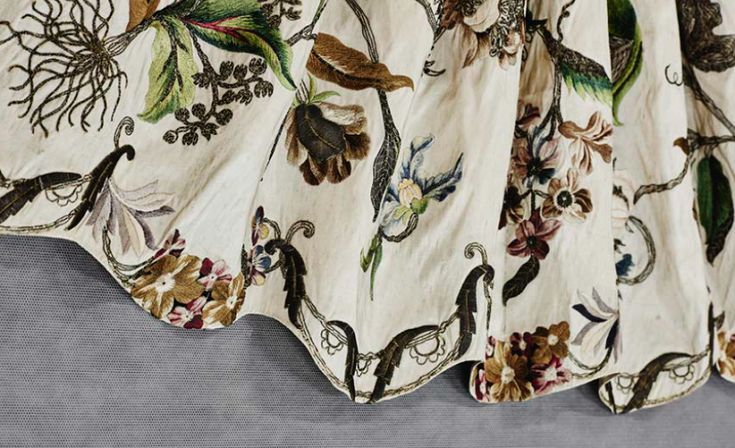 ENGLAND Apron (1730s) silk, silk thread, silver-plated brass thread, cardboard filling 43.2 (centre front) 24.0 cm (waist flat) Purchased, 1970