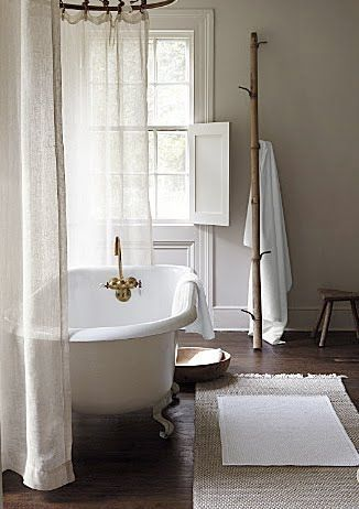 I love the claw foot / roll top bath. Beautiful old, simple, country bathroom: