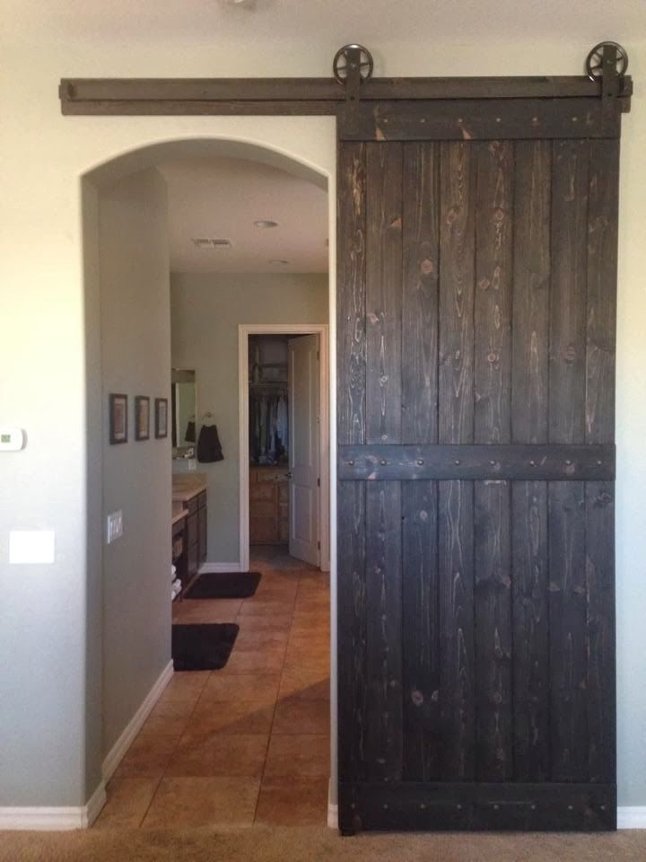 Barn Door Over Arched Opening For The Home Interior