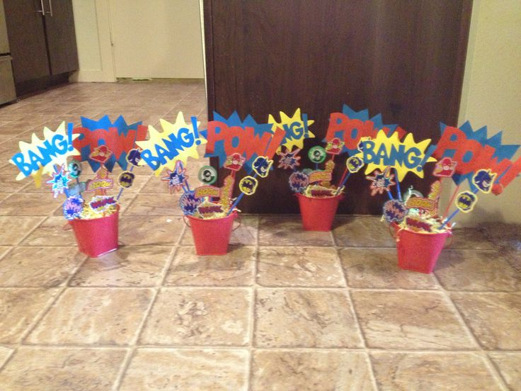 Superhero baby shower centerpieces - would be easy to print out all these designs!  Could use them for other decoration too, not just centerpieces