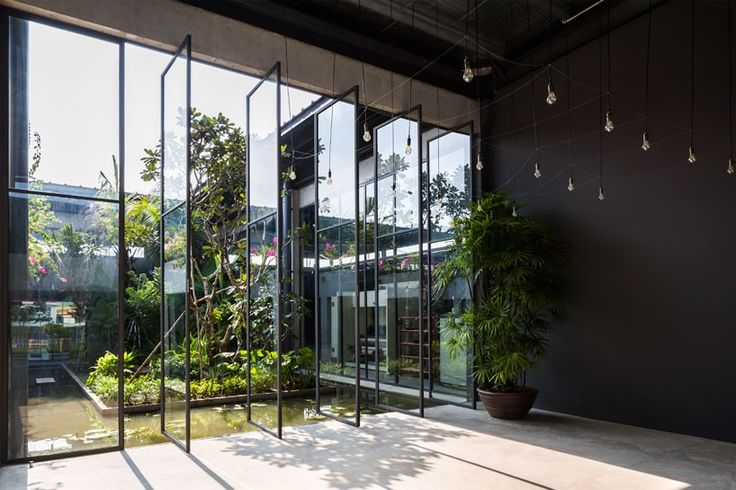 employees are brought closer to nature through the floor-to-ceiling rotating door system which opens onto a 16m x 16m open-air courtyard.